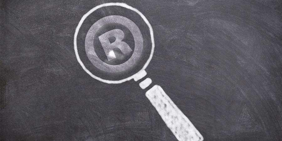 Magnifying glass, examining register mark